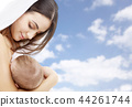 mother breast feeding baby over sky background 44261744