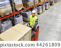 loader operating forklift at warehouse 44261809
