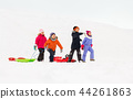 happy little kids with sleds in winter 44261863