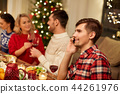 man calling on smartphone at christmas dinner 44261976
