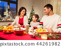 happy family having christmas dinner at home 44261982