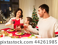 happy family having christmas dinner at home 44261985