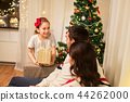 happy family with christmas present at home 44262000
