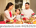 happy family having christmas dinner at home 44262020