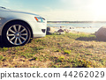 close up of car parked on sea shore or beach 44262029