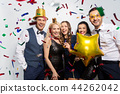 friends with party props and confetti laughing 44262042