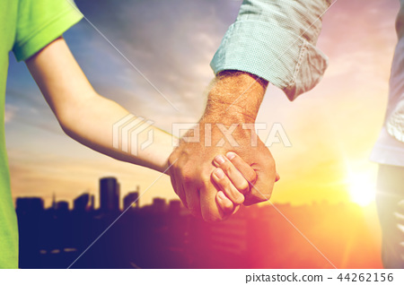 close up of grandfather and grandson holding hands 44262156