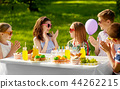 happy kids with cake on birthday party in summer 44262215
