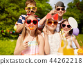 happy kids with party props on birthday in summer 44262218