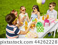 kids eating cupcakes on birthday party in summer 44262228