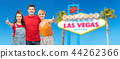 happy friends showing thumbs up at las vegas sign 44262366