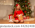 smiling girl with christmas gift at home 44262408