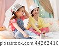 girls with kitchenware playing in tent at home 44262410