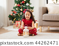 little girl with lantern at home on christmas 44262471