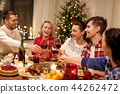 friends celebrating christmas and drinking wine 44262472