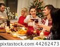 happy friends drinking red wine at christmas party 44262473