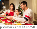 happy family having christmas dinner at home 44262503