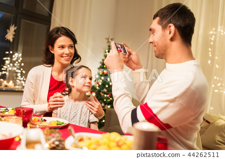happy family taking picture at christmas dinner 44262511
