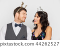 couple with christmas or new year party props 44262527