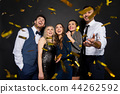 happy friends at party under confetti over black 44262592