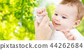 close up of sweet little baby with mother hand 44262684