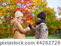 kids with autumn maple leaves over park background 44262726