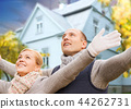 happy couple over living house in autumn 44262731