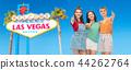 happy teenage girls showing thumbs up at las vegas 44262764