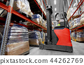 male loader operating forklift at warehouse 44262769
