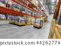 worker carrying loader with goods at warehouse 44262774
