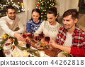 friends celebrating christmas and drinking wine 44262818