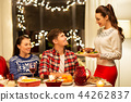 happy friends having christmas dinner at home 44262837