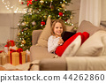 smiling girl with tablet pc at christmas home 44262860