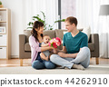happy family with flowers and baby boy at home 44262910