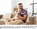 father with little baby girl at home 44262917