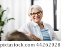portrait of happy senior woman in glasses at home 44262928