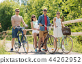 happy friends riding fixed gear bicycles in summer 44262952