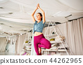 young woman doing yoga tree pose at studio 44262965