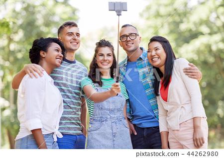international friends taking selfie in park 44262980