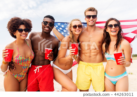 friends at american independence day beach party 44263011