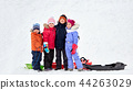 happy little kids with sleds hugging in winter 44263029