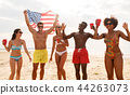 friends at american independence day beach party 44263073