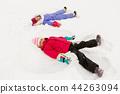 happy little girls making snow angels in winter 44263094