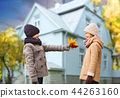 kids with autumn maple leaves over house outdoors 44263160