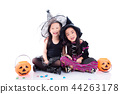 children in halloween costume sit on the floor  44263178