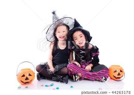 children in halloween costume sit on the floor  44263178