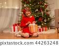 girl with christmas gift at home 44263248
