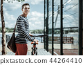 Positive energetic guy choosing bicycle for riding 44264410