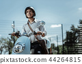 Positive male student taking ride on motorbike 44264815