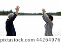 Asian Elderly couple Practice Qi Gong exercise  44264976